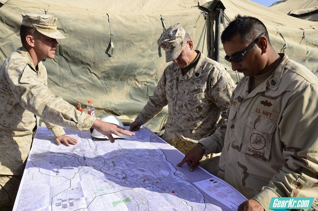 1280px-US_Navy_101211-N-6436W-053_Seabees_discuss_projects_while_looking_over_a_map_of_Kandahar,_Afghanistan